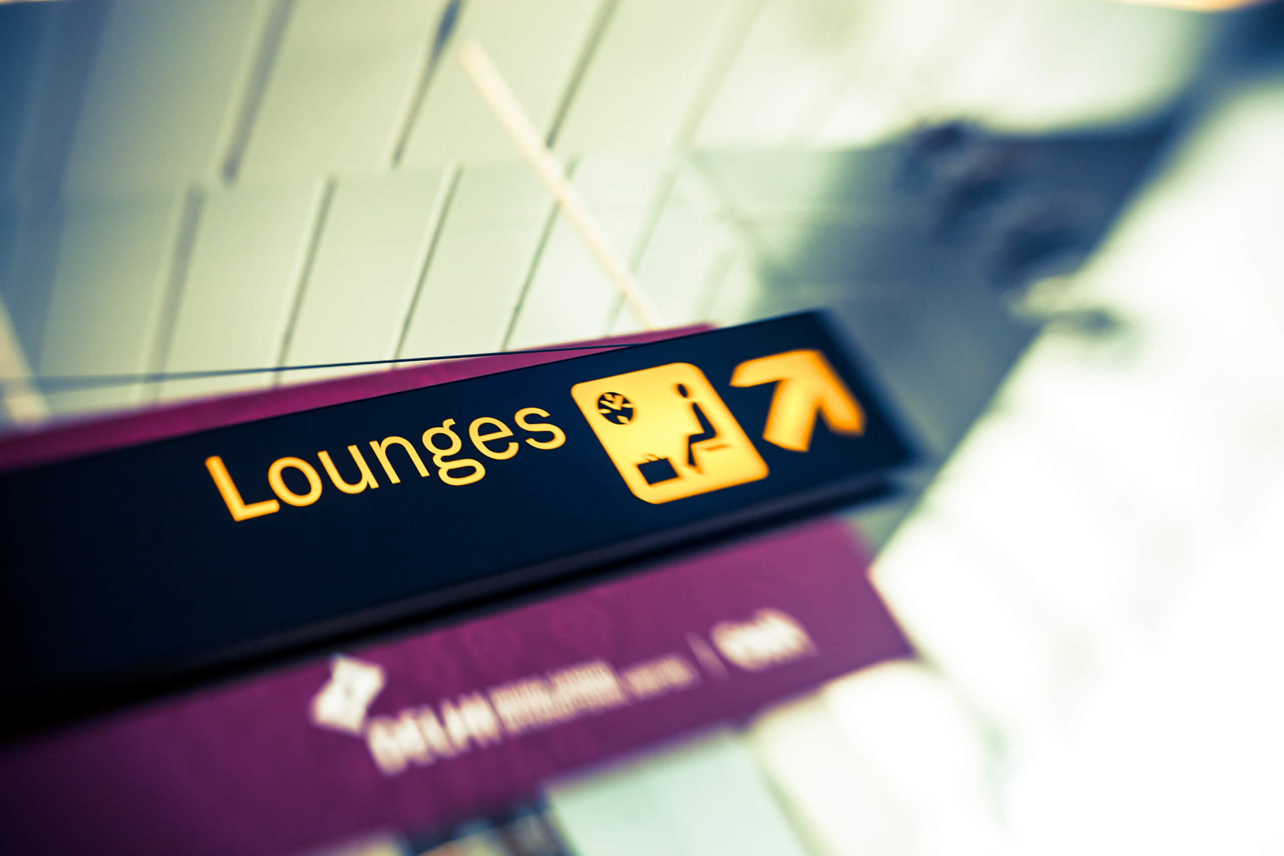 A sign in an airport for the airport lounges