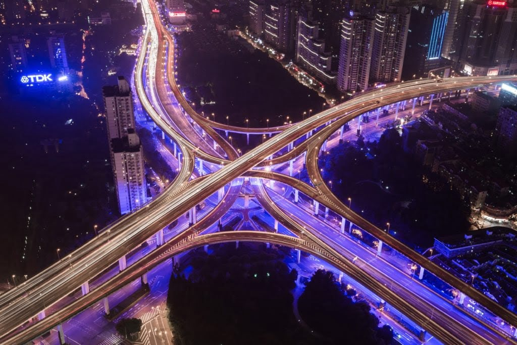 City interchange roads at night. Photo by Denys Nevozhai on Unsplash
