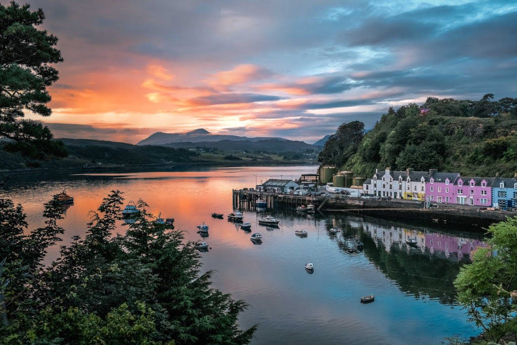 Dawn breaks over the colourful harbour of Portree, Isle of Skye.