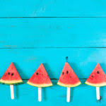 summer watermelon slice popsicles on a blue rustic wood background
