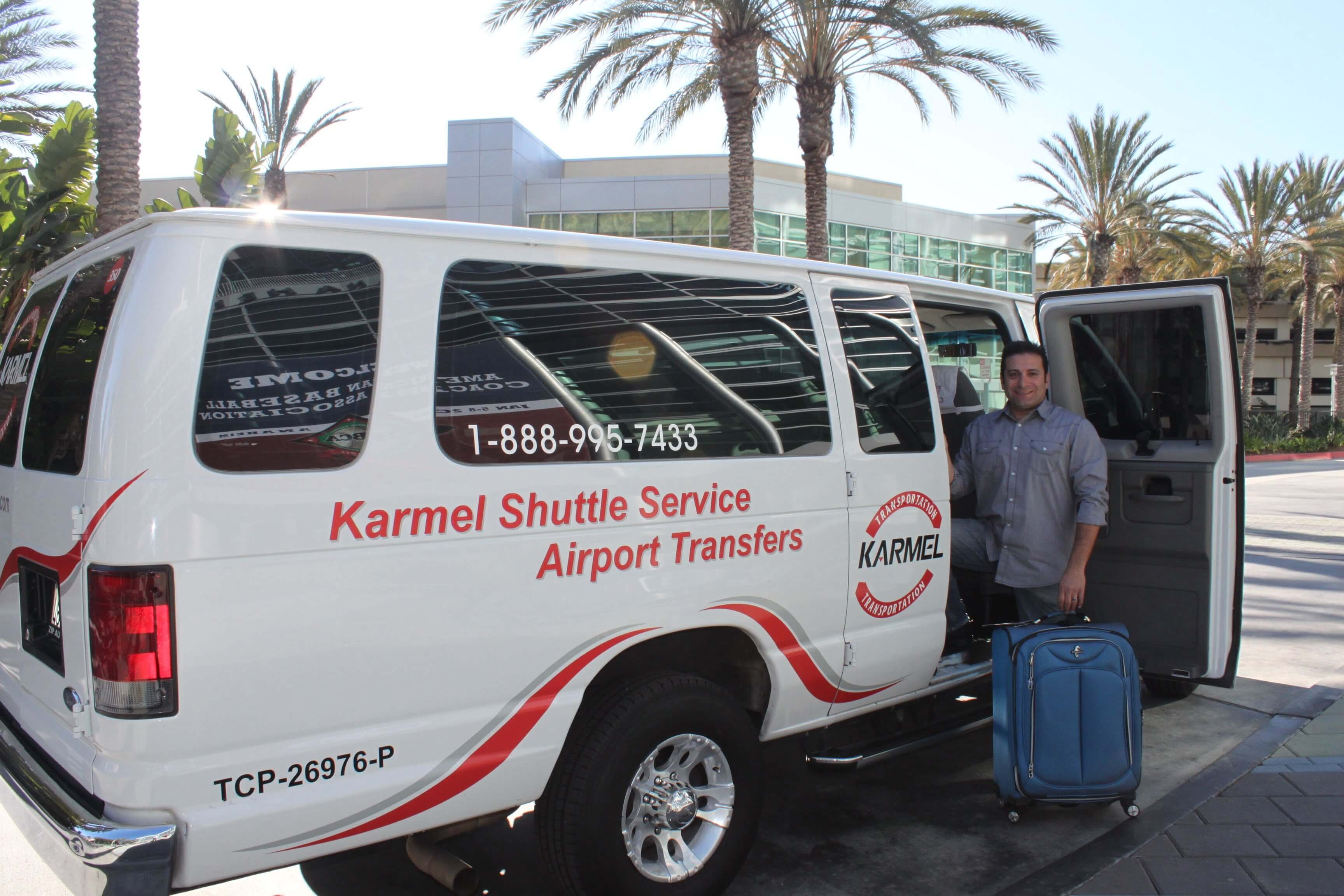 Mike Afram standing in front of Karmel Shuttle van