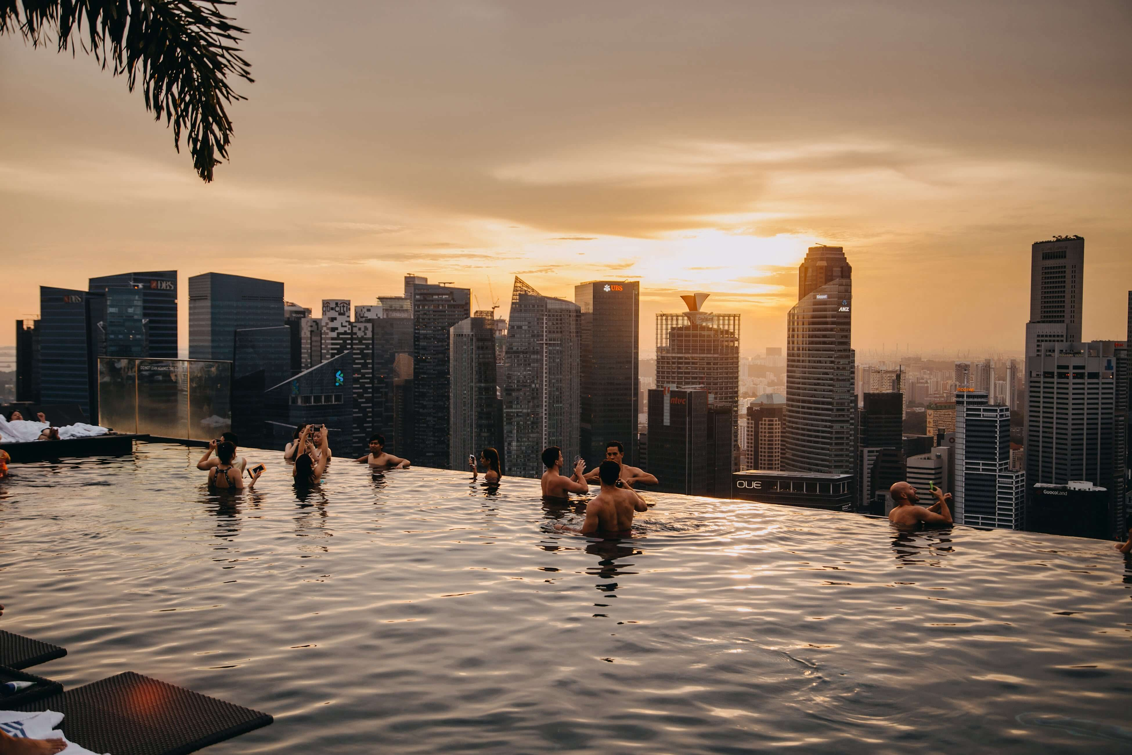 People swimming in the Marina Sands infinity pool