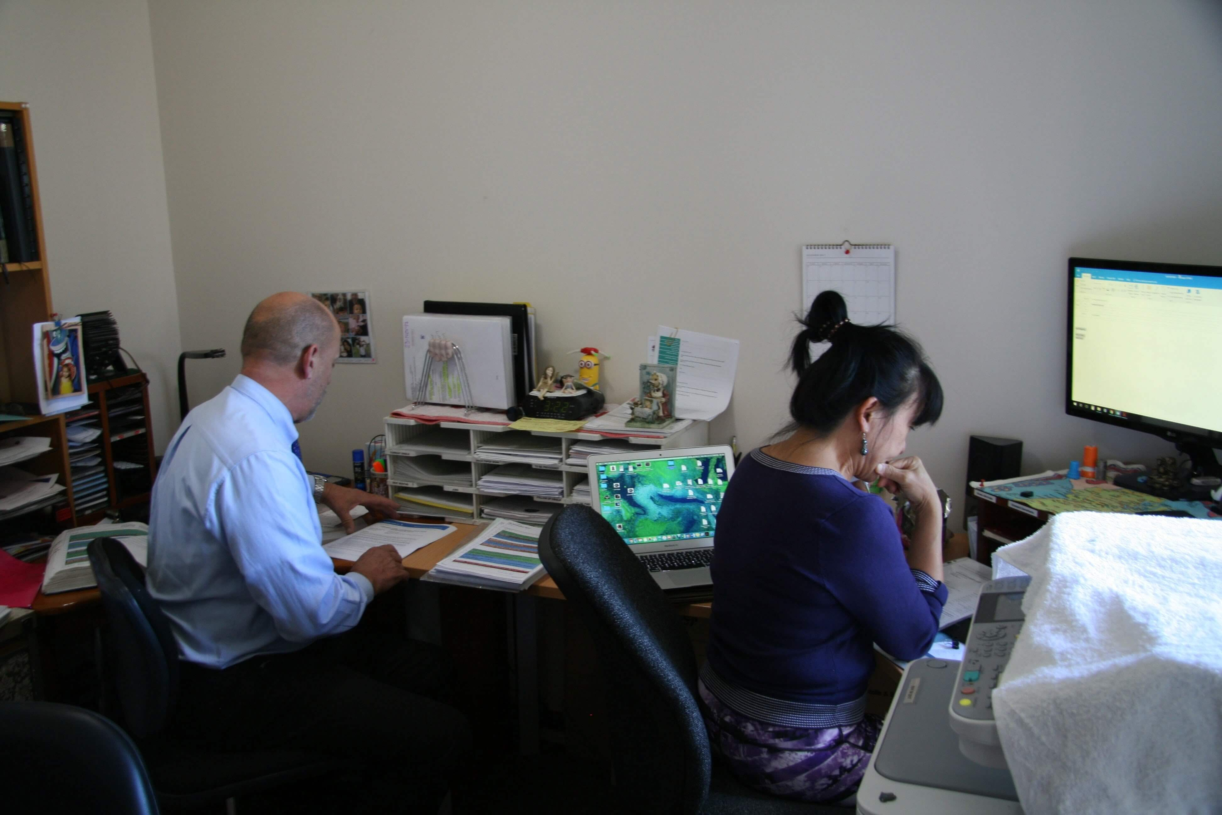 Kris Able and Visca Able working in their Sydney office