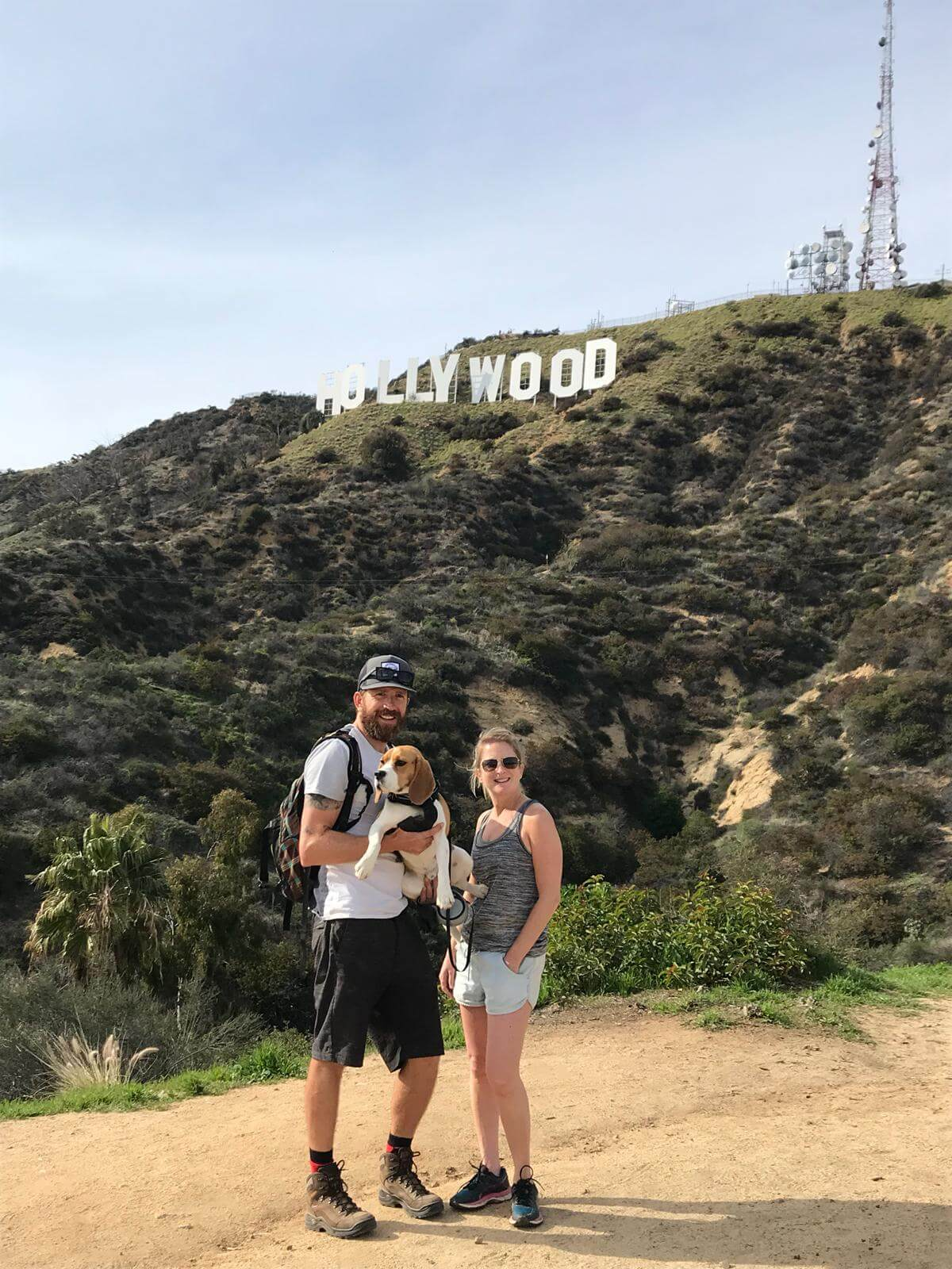 Lauren, Mike and their dog Stevie Beagle hiking near the Hollywood sign