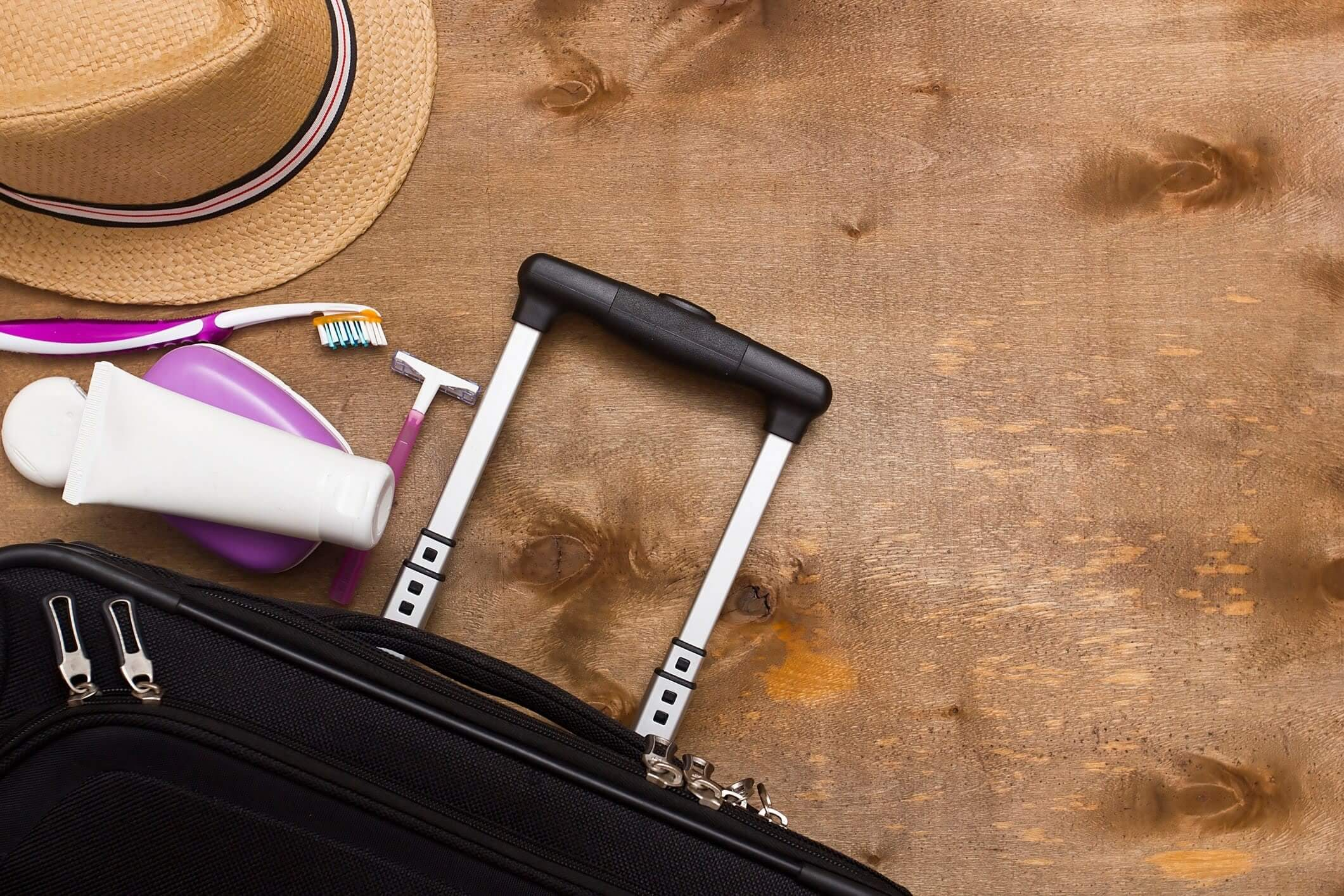 Suitcase with toiletries and hat