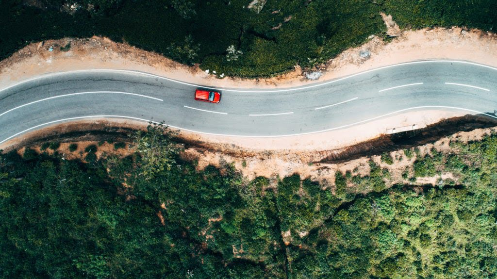 Aerial view of red car on road