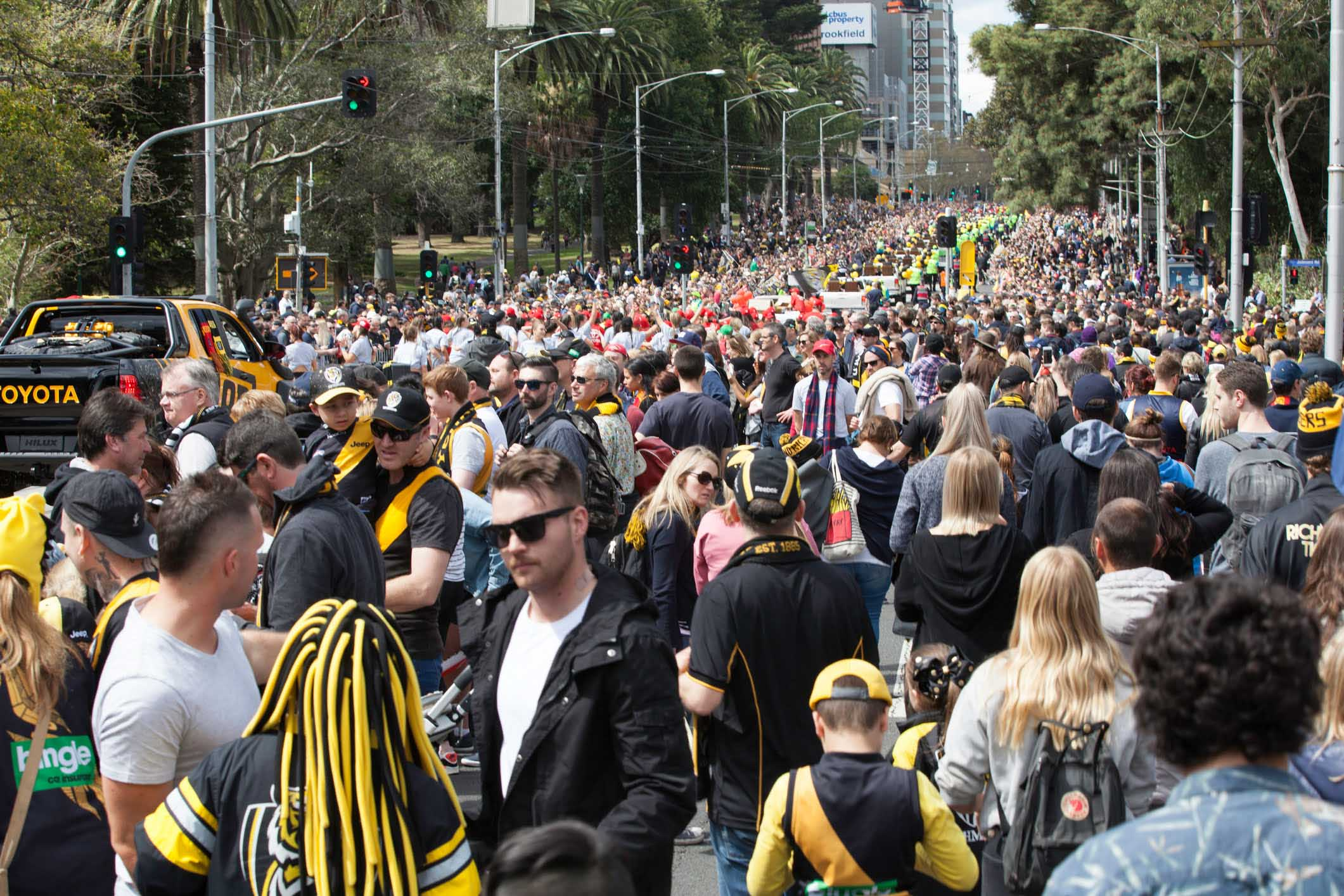 Crowds in Melbourne attending the AFL Grand Final Eve Parade