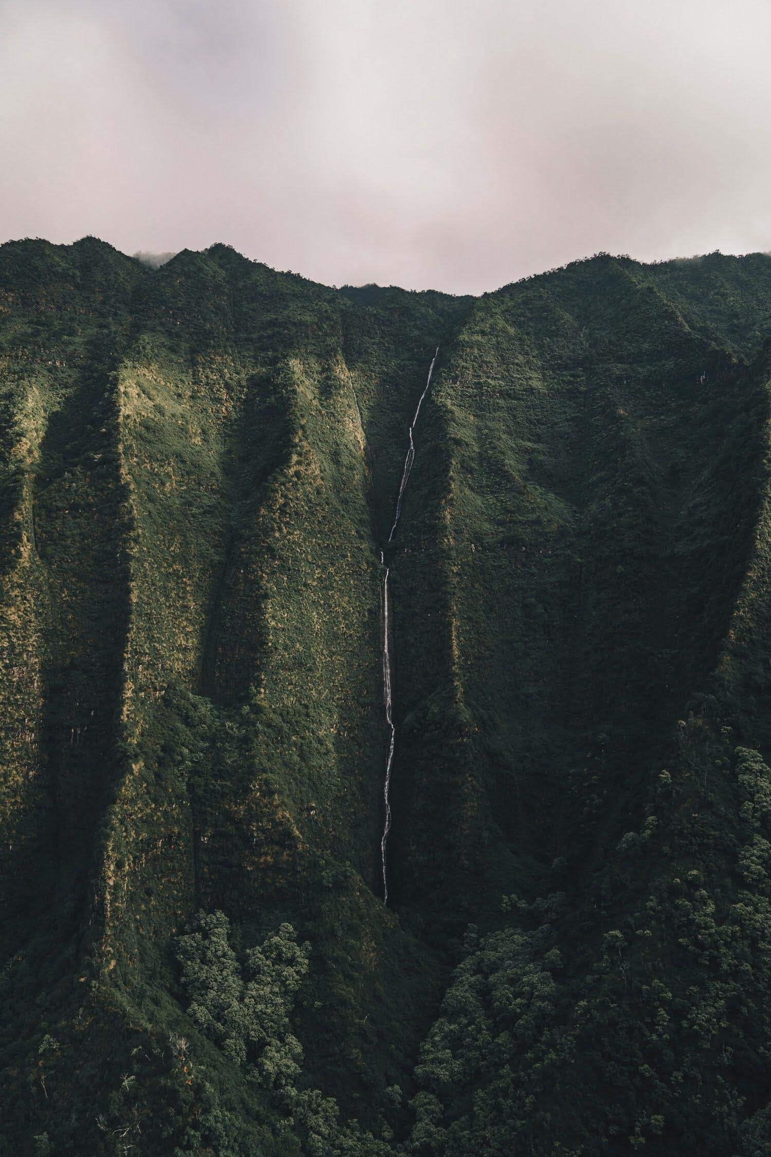 Waterfall in Kauai, US. Photo by Guille Pozzi on Unsplash