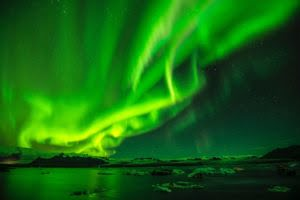 Aurora borealis. Photo by Paul Morris on Unsplash