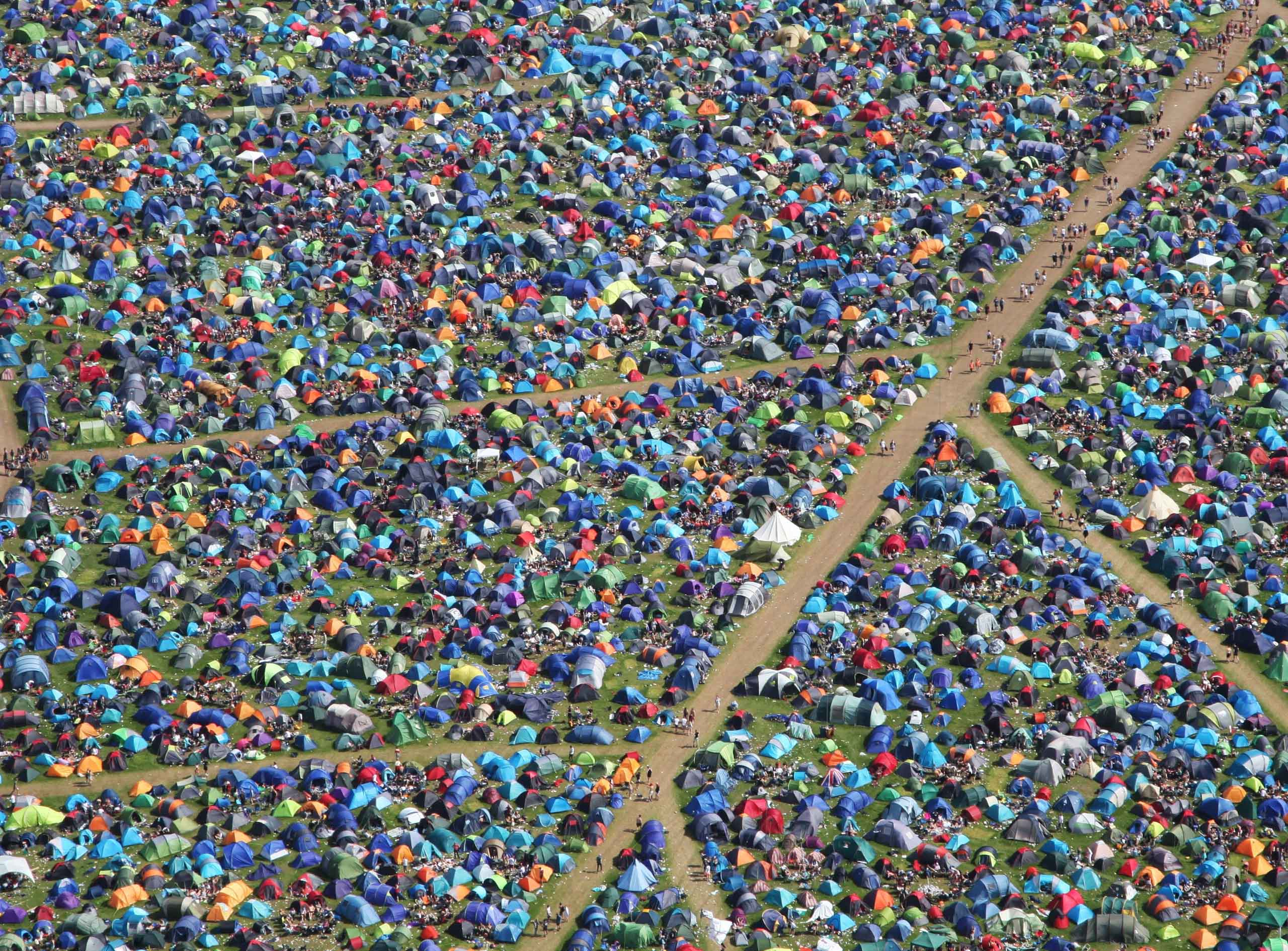 Aerial view of rows of tents. Photo by John Such on Unsplash