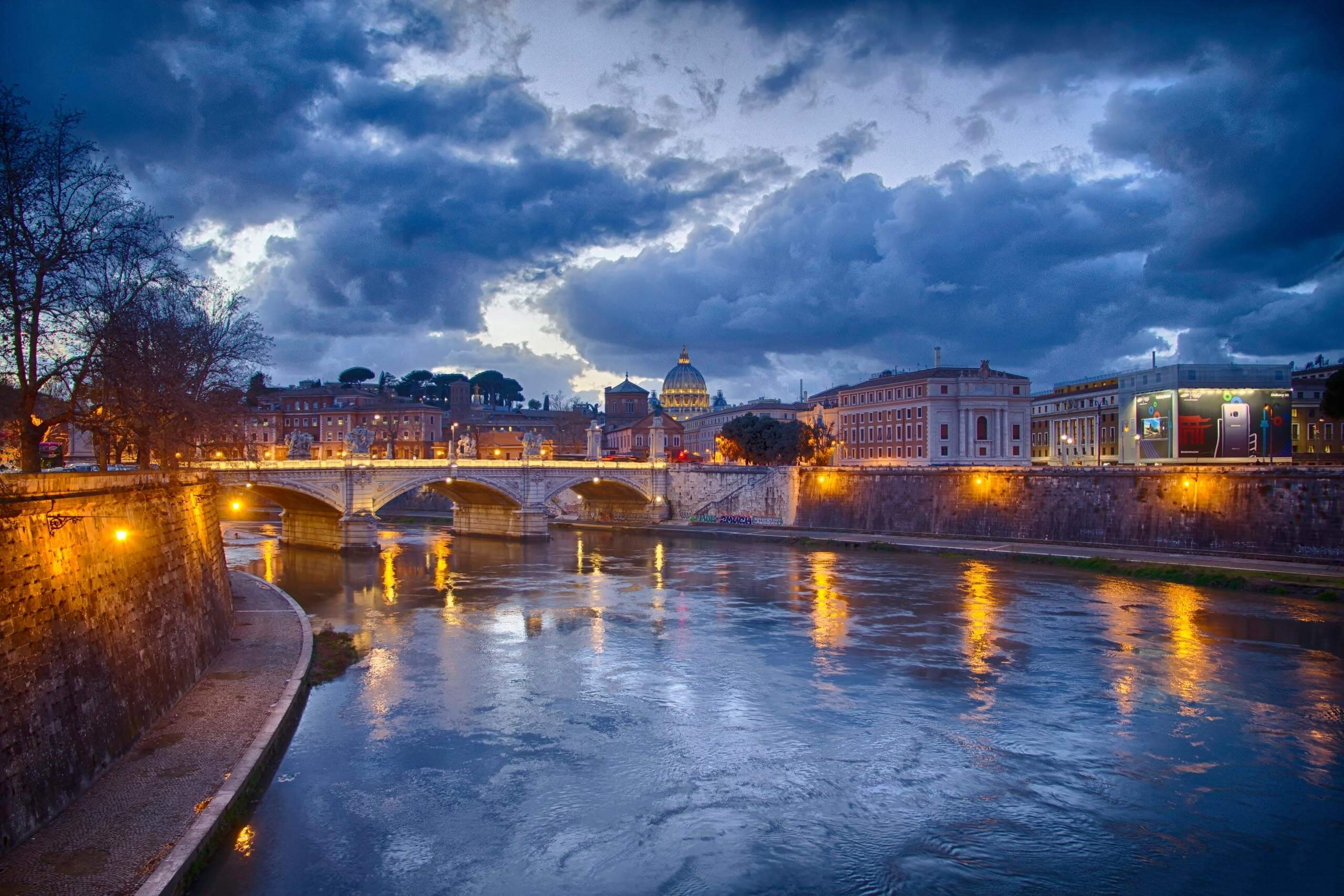 Shot of Rome with bridge and river. Photo by Christian Nordmark on Unsplash
