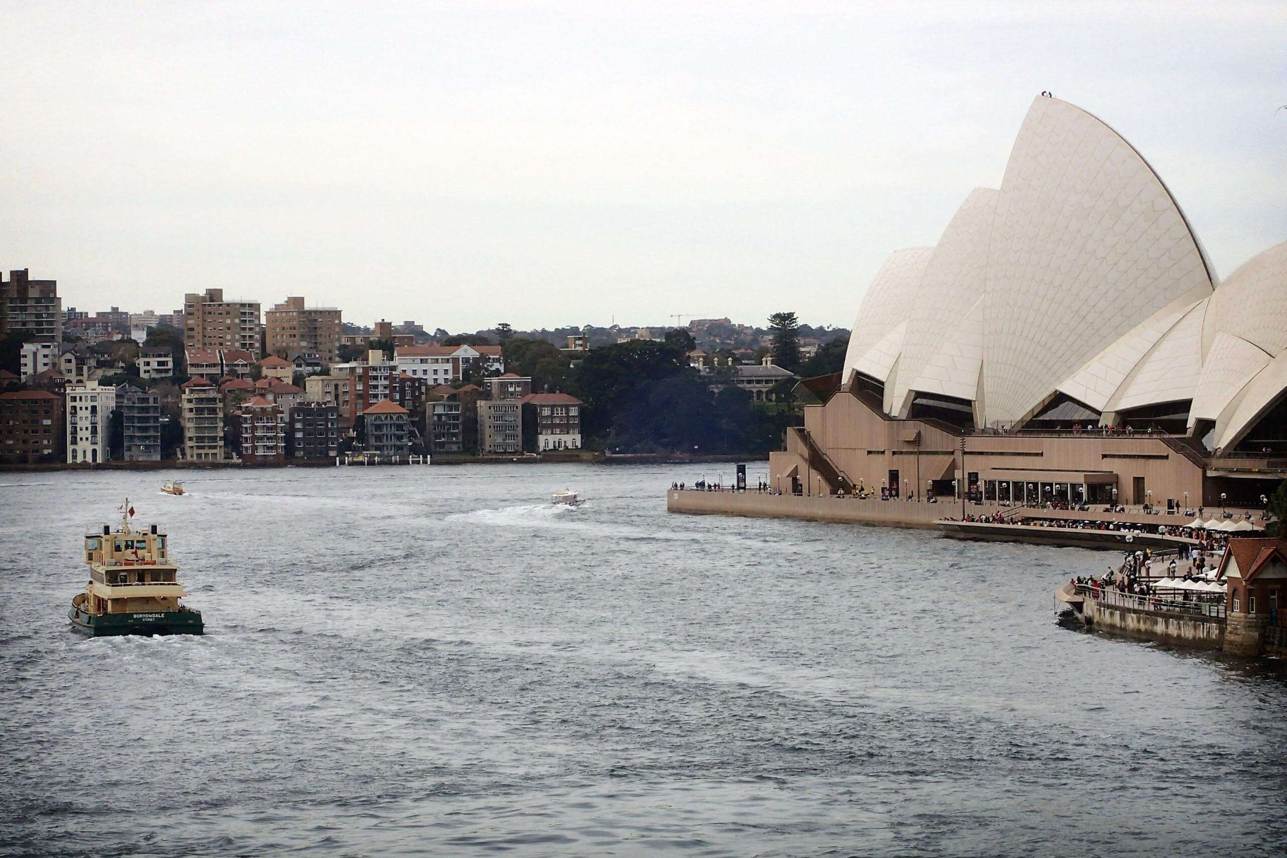 Sydney ferry next to Sydney opera House. Photo by Gabriel Ben-Yosef