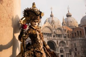 Person wearing historical Carnevale mask and costume