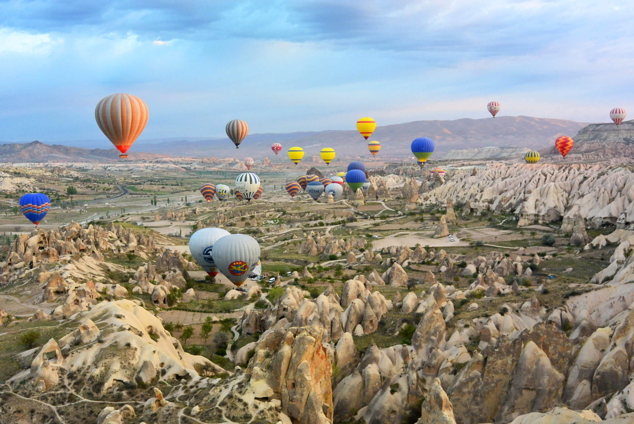 Hot air balloons over the Cappadocia region in Turkey. Photo by Mar Cerdeira on Unsplash