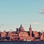 Valletta skyline at sunset. Photo by Micaela Parente on Unsplash