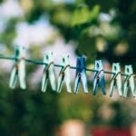 Green and blue pegs on a line. Photo by FancyCrave on Unsplash
