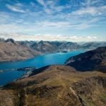 Aerial view of Queenstown, Lake Wakatipu and the surrounding mountains. Photo by Samuel Ferrara on Unsplash